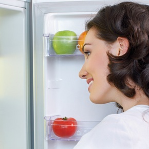 Woman Opening Fridge Door