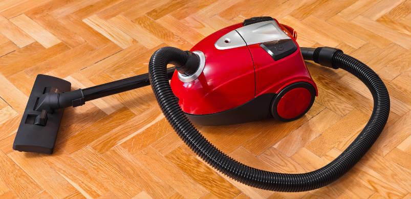 Vacuum On Wooden Floor