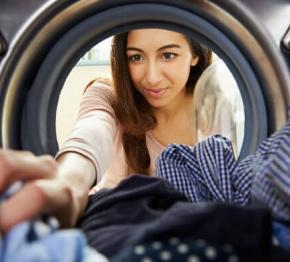 Women Unloading Tumble Dryer