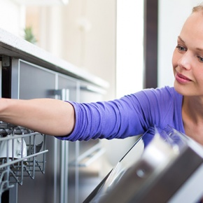 Woman Opening Dishwasher Door
