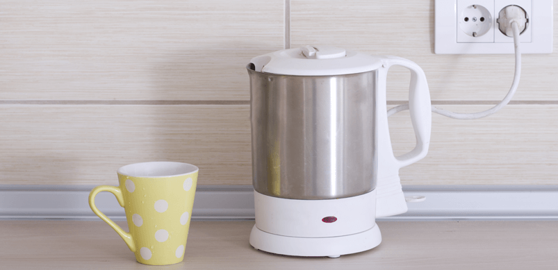 Kettle And Cup In Kitchen