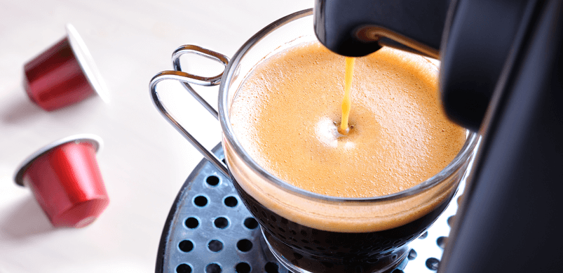 Coffee Being Poured From Machine Into Cup