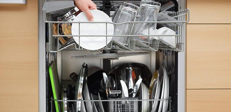 Person Filling Dishwasher
