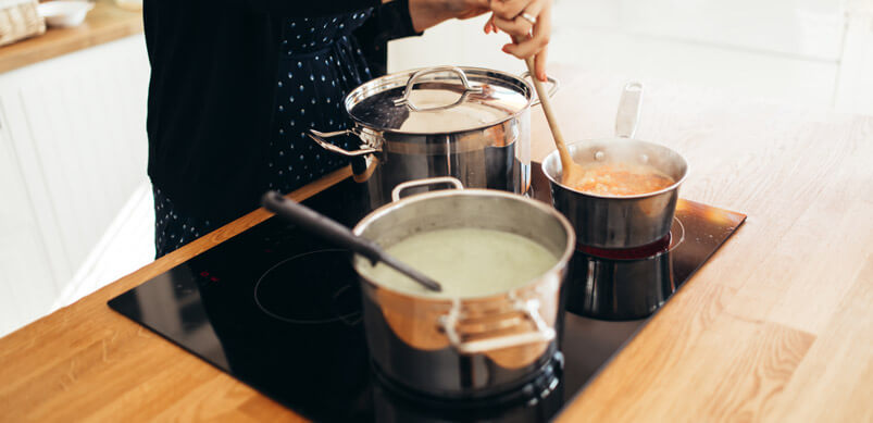 Saucepans Cooking Food On Cooker Hob