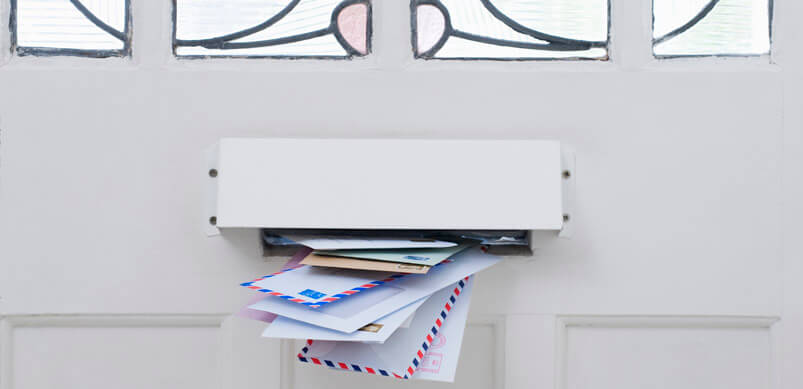 Wodge Of Bills In Letterbox