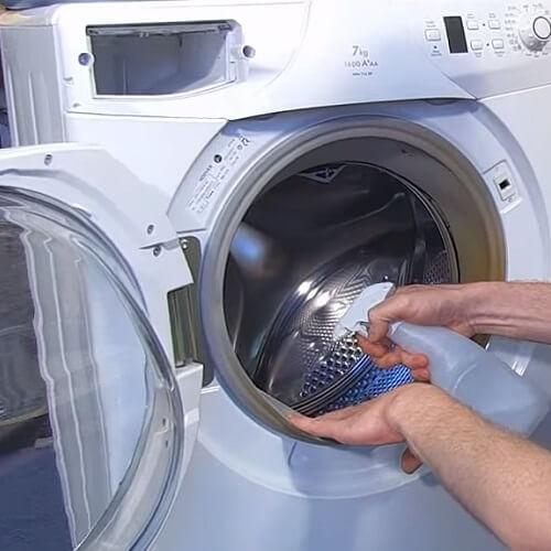 Spraying Washing Machine Door Seal With Cleaner