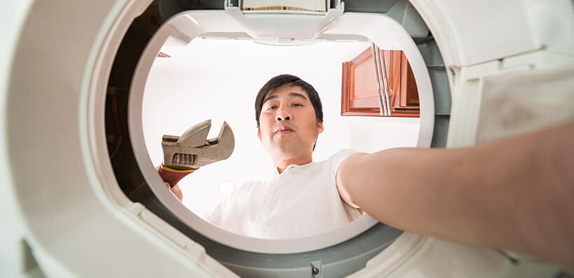 Man Repairing His Washing Machine Himself