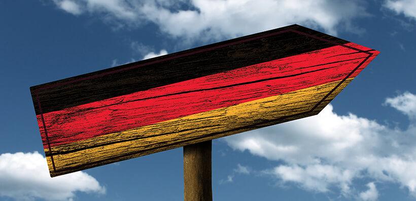 German Flag On Signpost