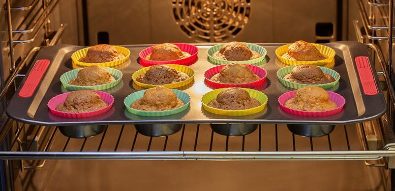 Cakes In Baking Tray In Oven