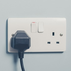 White Plug Socket On Blue Wall