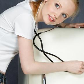 Woman Diagnosing Fridge With Stethoscope