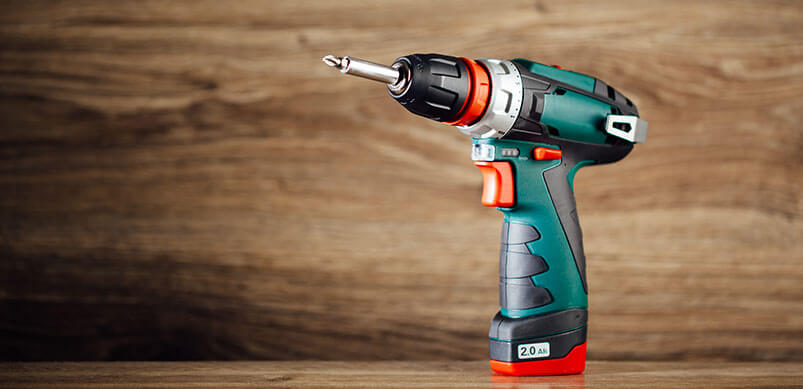 Cordless Drill On Wooden Surface