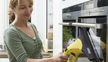 Woman Cleaning Oven With Window Vacuum