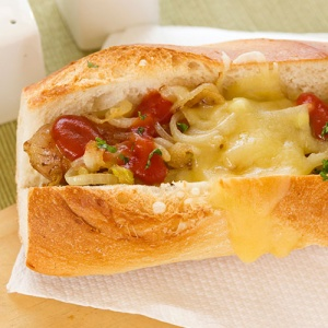 Beer Braised Onion And Melted Cheese Hotdog