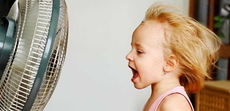 Girl Using Fan To Keep Cool