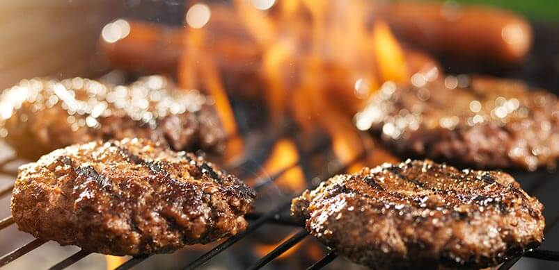 Hamburgers And Sausages On BBQ