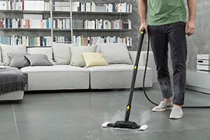 Man Steam Cleaning FLoor