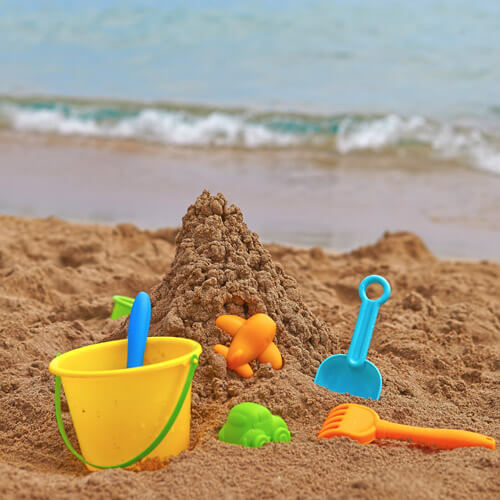 Buckets And Spades On Beach