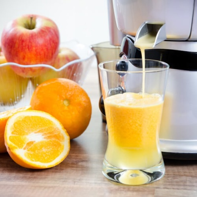 Juicing Appliance Dispensing Orange Juice
