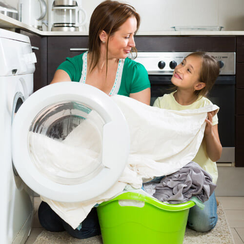 Woman Doing Laundry With Daughter