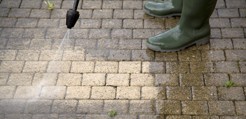 Pressure Washer Cleaning Patio