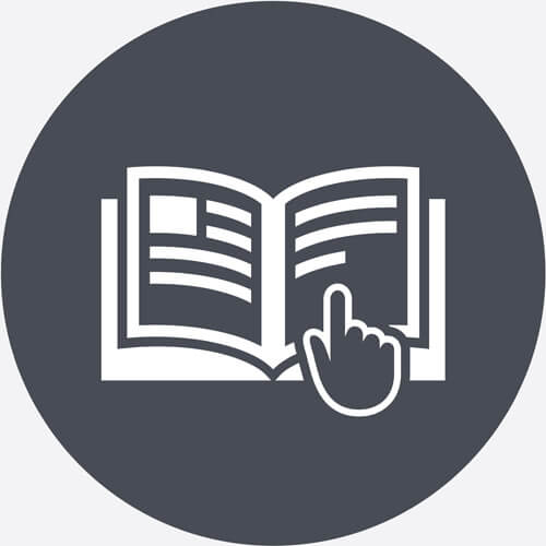 Hand Finding Place In Appliance Manual