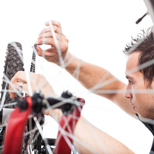 Man Fixing Bicycle Chain
