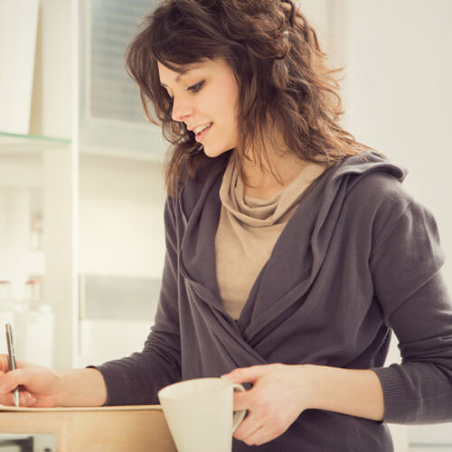 Woman Drinking Tea And Writing