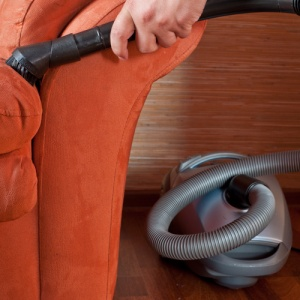 Cleaning Sofa With Vacuum Attachment