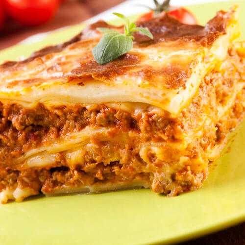 Close Up Lasagne On Green Plate