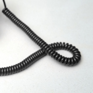 Coiled Black Cable On White Background