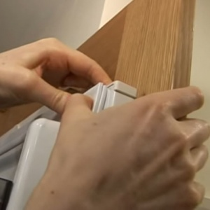 Hands Feeling Fridge Door Seal