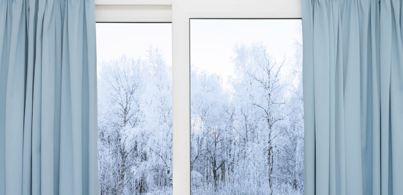 Open Curtains With Frosty Trees Outside