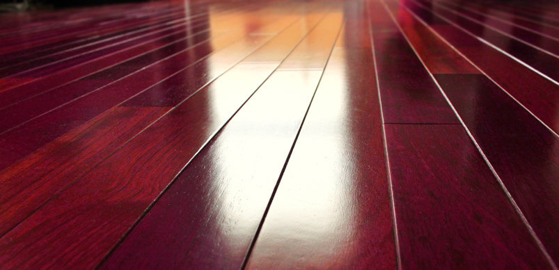 Polished Dark Wooden Floorboards