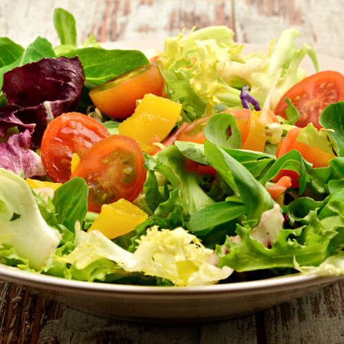 Salad With Lettuce Tomatoes And Yellow Pepper