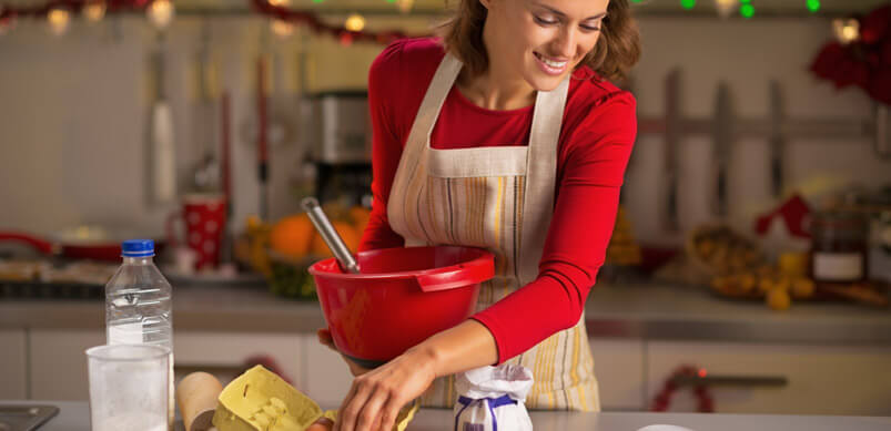 Woman Doing Christmas Baking With Clean Kitchen Appliances