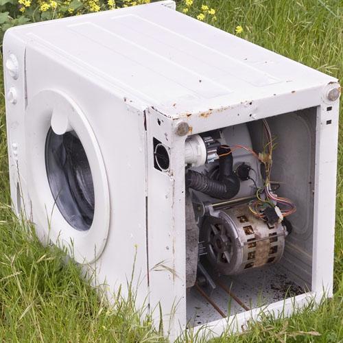 Abandoned Washing Machine On Grass
