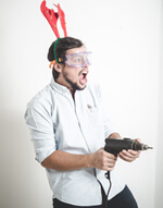Man Holding A Drill Wearing Antlers