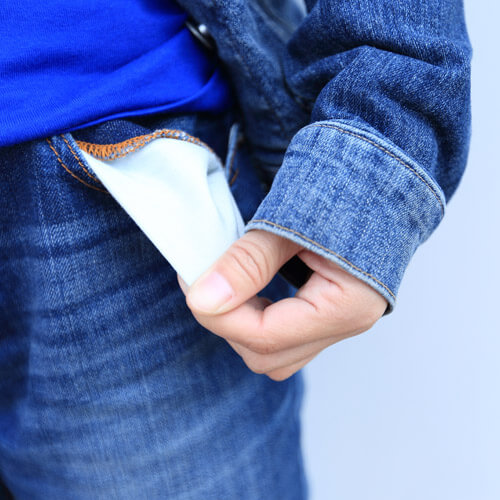 Person Turning Out Jeans Pockets