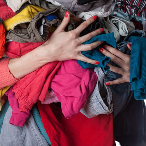 Woman Holding Bundle Of Clothes