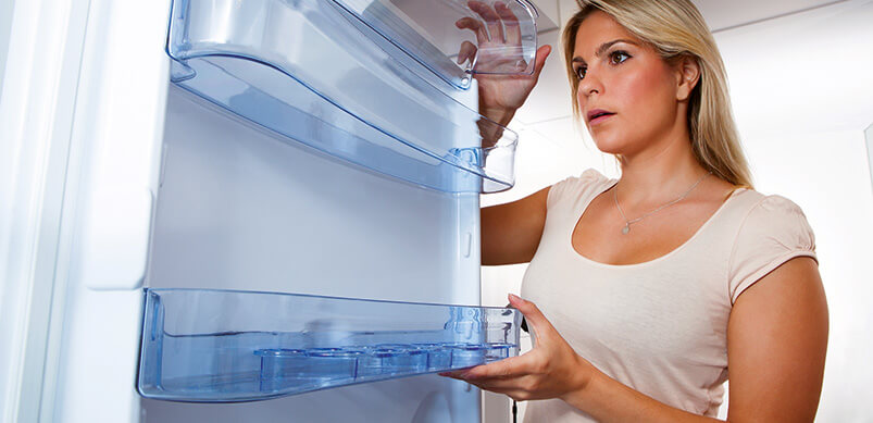Woman Moving Fridge