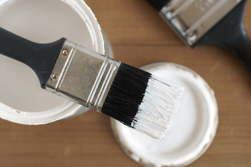 Paintbrush On Open Paint Tin