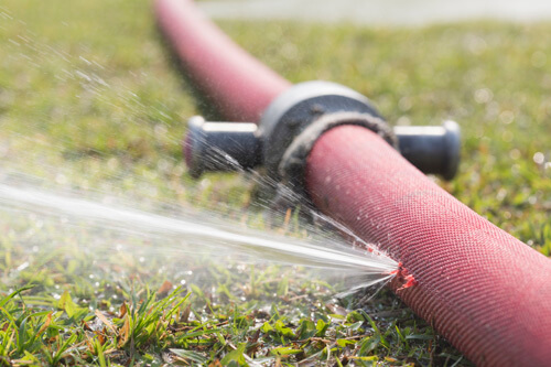 Red Hose On Lawn Leaking