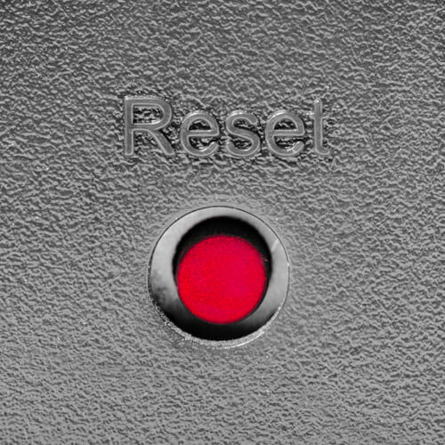 Red Reset Button On Silver Background