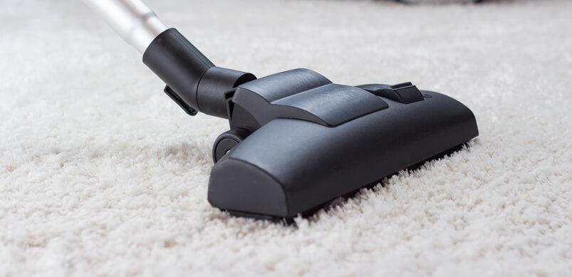 Vacuum Cleaner On White Carpet