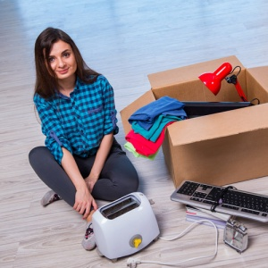 Woman Packing Toaster And Other Small Electricals