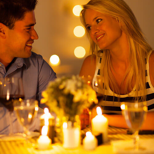 Couple Enjoying a Candlelit Dinner