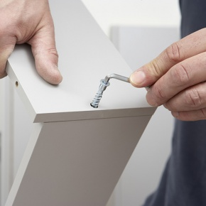 Close Up Of Man Assembling Flat Pack Furniture