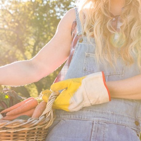 Woman Holding A Basket Of Home Grown Produce