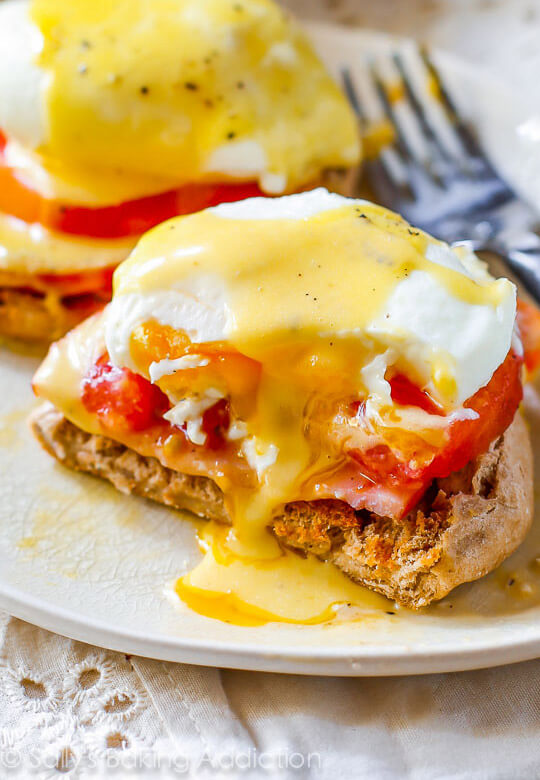 Homemade Eggs Benedict With Bacon And Tomato